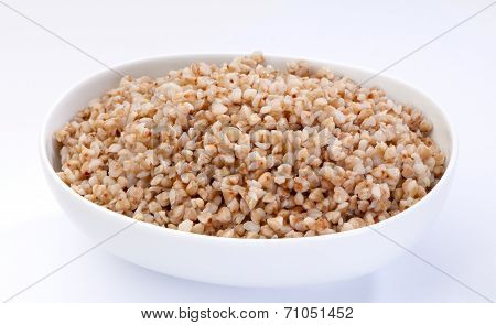 Bowl of boiled buckwheat close-up