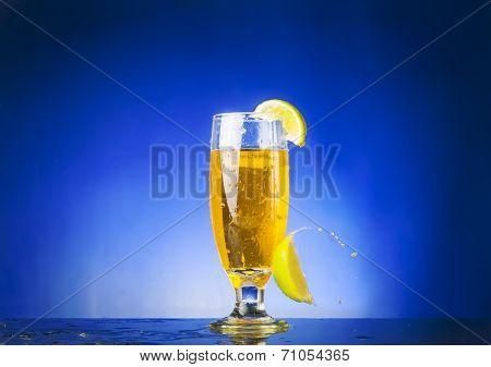glass with  yellow liquid
