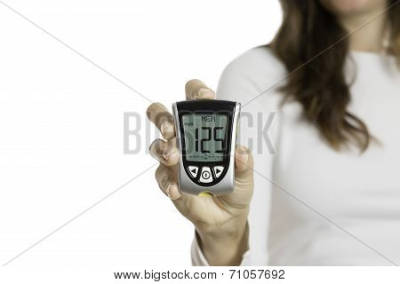 Hand Holding A Glucometer