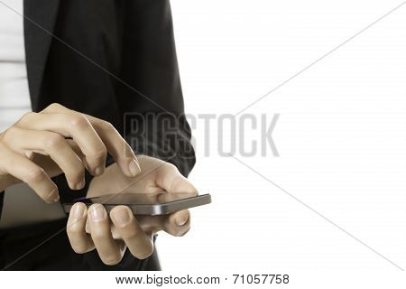 Hands Of Business Woman Using A Mobile Phone
