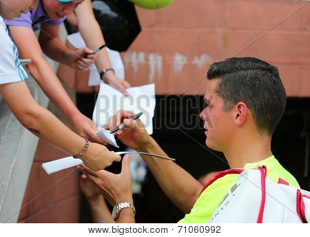 Professional tennis player Miols Raonic signing autographs after third round match at US Open 2014
