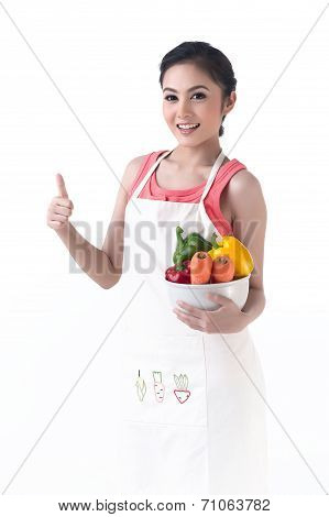 Housewife Holding A Bowl Of Vegetable And Thump Up
