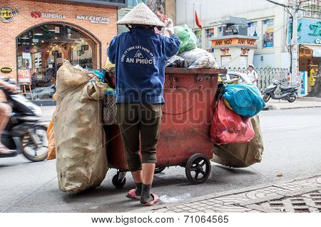 Worker of urban municipal recycling garbage collector waste and trash bin