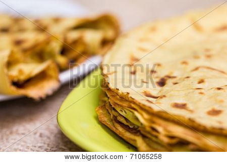 Fresh Pancakes On Plate. Close Up Of A Homemade Crepe With Jam Filling, Shallow Depth Of Field.