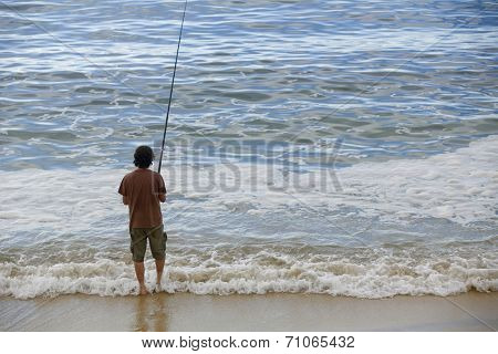 fisherman at the sea, in the north of spain
