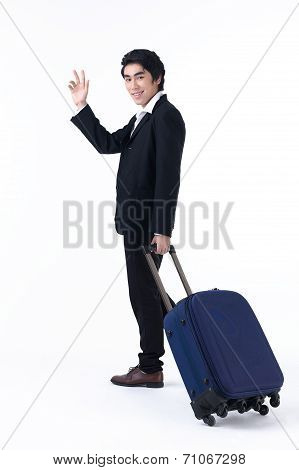 Business Man Pulling Luggage And Waving Hand