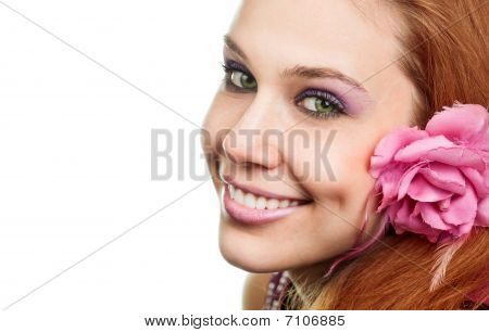 Happy Woman With Flower At Ear Isolated On White