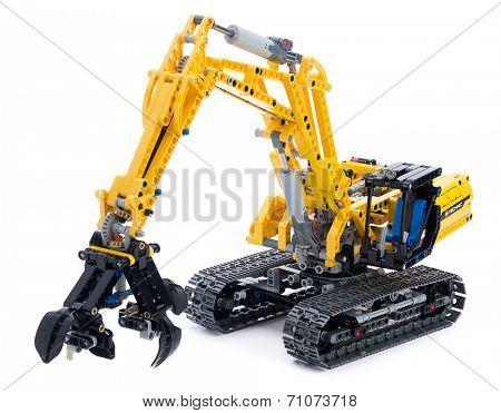 Ankara, Turkey - October 27, 2013:  Lego technic excavator isolated on white background.