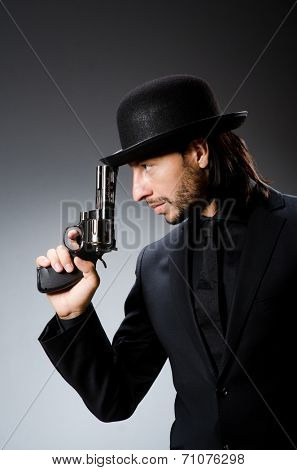 Man with gun and vintage hat