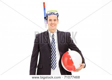 Businessman with snorkeling mask and beach ball posing isolated on white background