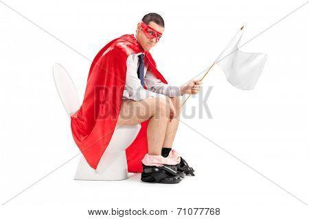 Superhero holding a white flag seated on toilet isolated on white background