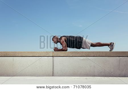 Strong Young Athlete Doing Core Exercise