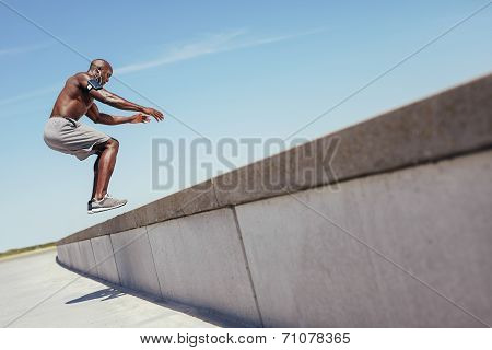 Muscular Man Doing Box Jumps Outdoors.