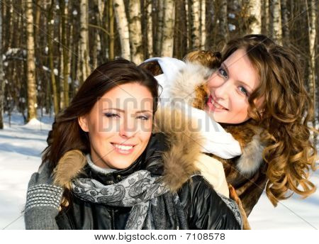 Smiling Girls In Winter Forest