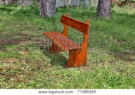 A wooden bench for resting in a mountain yard