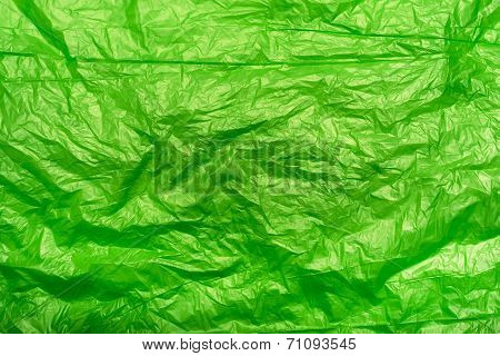 Crumpled Green Plastic Bag Fragment As An Abstract Texture