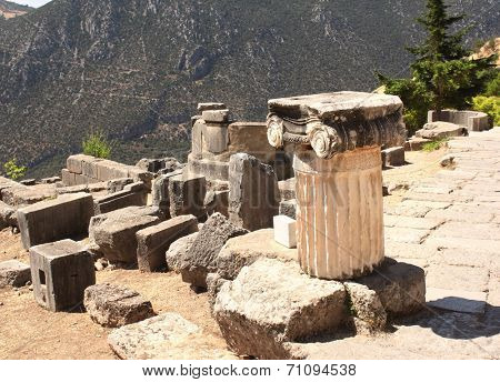 Ancient column in the archaeological site of Delphi, Greece