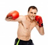 image of muay thai  - Caucasian kickboxer or muay thai fighter executing a punch with motion blur - JPG