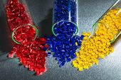 stock photo of vitro  - blue red and yellow polymer resin in test glasses on steel sheet - JPG