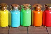 pic of pigment  - Bottles with colorful dry pigments on bamboo mat background - JPG