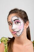 stock photo of face painting  - Beautiful young girl portrait with face painting - JPG