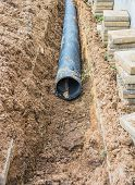 picture of underground water  - installing tap water pipeline on the walkway - JPG