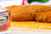 pic of barbie  - Large slab of meat seasoned ready to be cooked in smoker - JPG