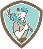 picture of monkeys  - Illustration of a plumber holding monkey wrench on shoulder set inside shield crest on isolated background done in cartoon style - JPG
