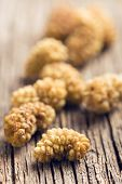 foto of mulberry  - dried mulberry on old table - JPG