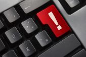 picture of explicit  - dark grey keyboard red button exclamation mark danger - JPG