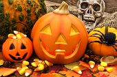 image of jack o lanterns  - Halloween Jack o Lantern scene with candy and decor - JPG