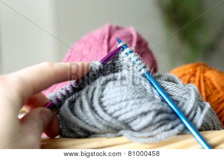 Woman Knitting With Gray  Wool.