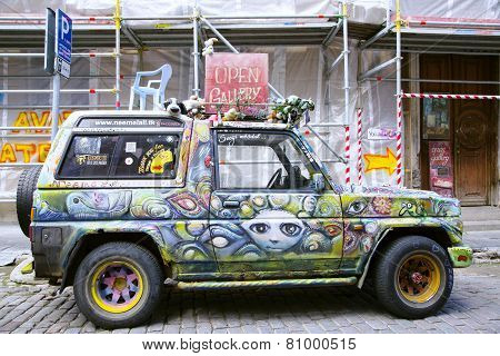 Old painted car in street