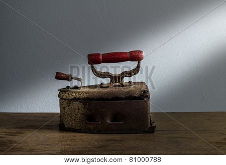 Retro Still Life With Old Rusty Iron On Wooden Background