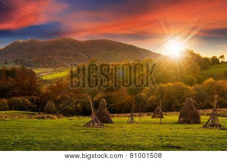 Agriculture Field In Mountains At Sunset