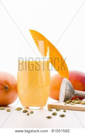 Glass Of Mango Smoothie Decorated With Fruit Slice