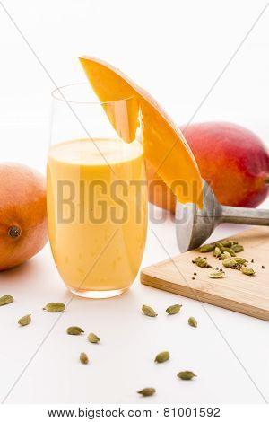 Decorated Mango Milk Shake And Crushed Cardamon