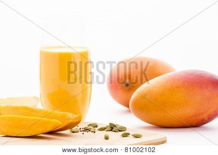 Mangos, Cardamon And Mango Yoghurt Drink On White