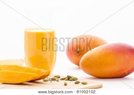 Mangos, Cardamon And Mango Yoghurt Drink On White