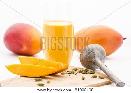 Crushed Cardamon, Pestle, Mangos And Mango Lassie