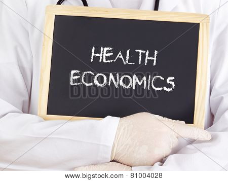 Doctor Shows Information On Blackboard: Health Economics