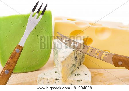 Delicious cheese and knife on wood platter.