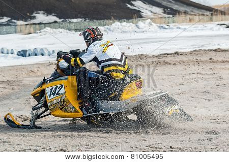 Snowmobile rider on sport track