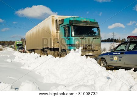 Trucks stopped on highway after heavy snow storm