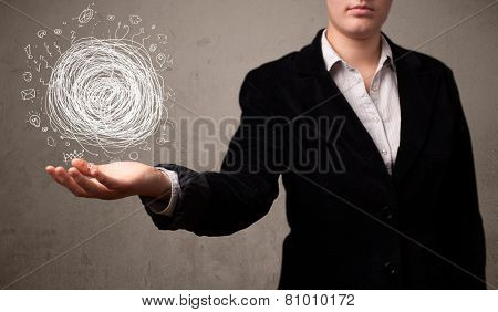Young businesswoman holding chaos concept in her hand