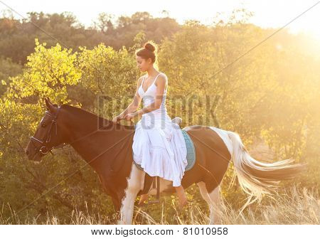 Beautiful Woman Riding On A Horse