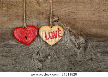 Love Valentines Message Two Wooden Hearts Sign On Rough Grey Background