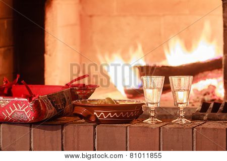 Two Glasses Of Vodka At Firewood Oven Background