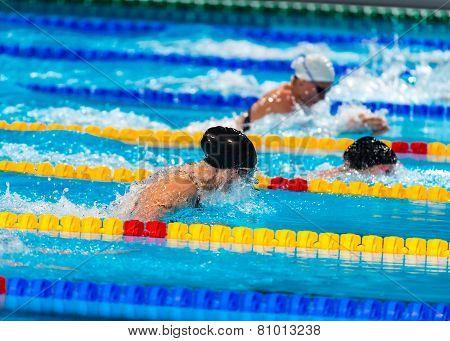 Breaststroke Girls Swimmers In Swimming Race