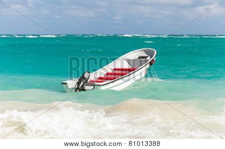 White Pleasure Boat Floats On Stormy Ocean Water